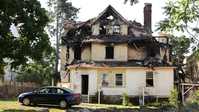 The rear of 10 Hamilton Ave. in New Rochelle is pictured after an overnight fire killed one person, July 18, 2016.