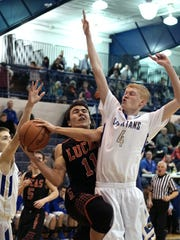 Lucas' Rueben Luna gets fouled by St. Pete's Kyle Osgar