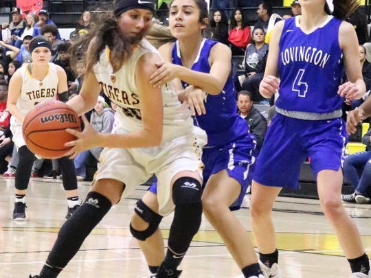 Alamogordo's Faith Silva tries to get by a Lovington
