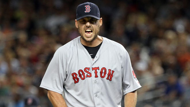 John Lackey won two games for the Red Sox in the 2013 World Series.