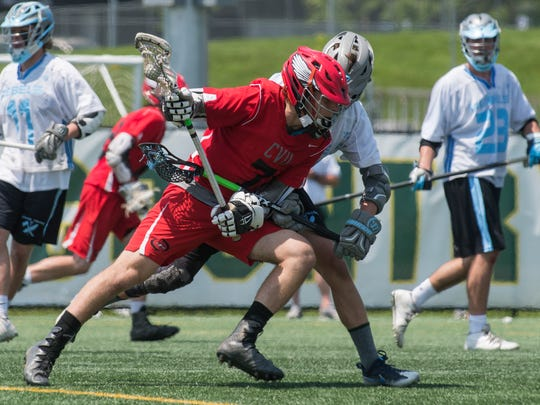 CVU's Xander Miller (7) runs with the ball during the Division I boys lacrosse championship game between the Champlain Valley Union Redhawks and the South Burlington Rebels at UVM's Virtue Field on Saturday June 10, 2017 in Burlington.