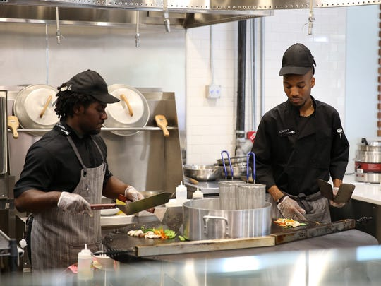 Chefs run the Mongolian grill at Passport, one of the