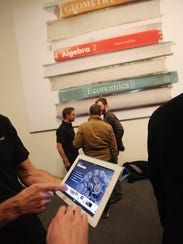 Apple's new iBooks 2 app is demonstrated for the media on an iPad at an event in the Guggenheim Museum January 19, 2012 in New York City.