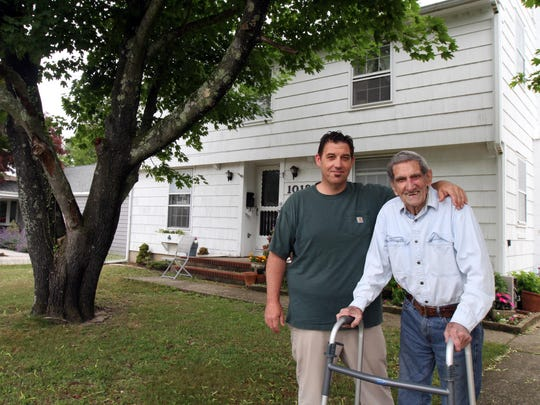 """(right) Shawn Shaughnessy considers himself a second-generation """"clam digger,"""" someone born and raised in Point Pleasant. He stands with his 89-year-old father, Paul Shaughnessy, in front of the family home in Point Pleasant."""