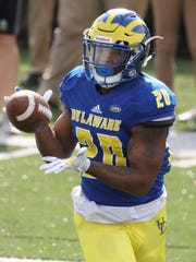 Khory Spruill hauls in a pass during Delaware's Blue-White Spring game at Delaware Stadium.