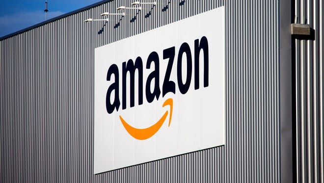 The Amazon logo is seen on the new logistics center of the online merchant in Lauwin-Planque, northern France.