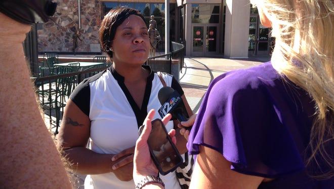 Shanesha Taylor talks with media outside court on Nov. 6, 2014.