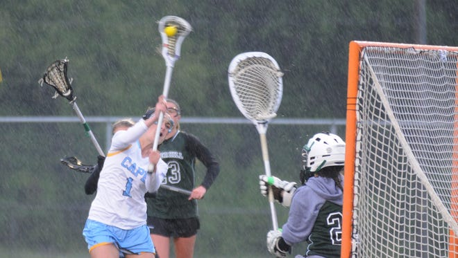 Cape Henlopen's Lizzie Frederick (1) runs in for a shot against Tower Hill. Frederick scored but was called for a crease violation during the DIAA girls lacrosse semifinals.