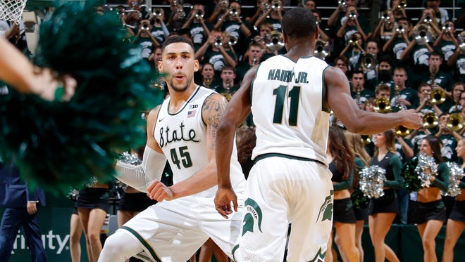 Michigan State's Denzel Valentine, left, and Lourawls Nairn Jr.  celebrate following a 71-67 win over Louisville on Wednesday, Dec. 2, 2015, in East Lansing.