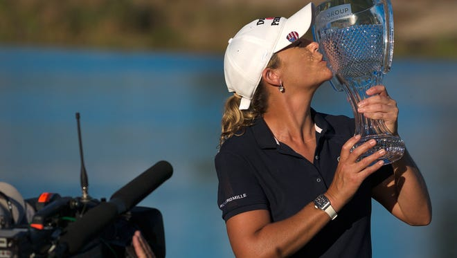 LPGA Tour pro Cristie Kerr poses with the CME Group Tour Championship trophy after winning the event at Tiburon Golf Club on Sunday, Nov. 22, 2015, in North Naples.  Kerr won the event at 17-under, one stroke over Ha Na Jang and Gerina Piller.  (David Albers/Staff)