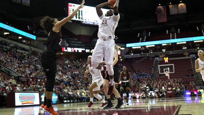 FSU's Shakayla Thomas shoots over Virginia Tech's Alexis Jean during their game at the Tucker Civic Center on Sunday, Jan. 14, 2018.