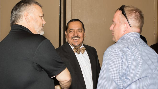 Steve Chavira is all smiles at the 2016 Anniversary House Celebration. Also pictured, at left, are Bret Thompson and, at right, Wagner of Foxworth Galbraith.