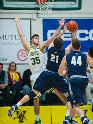 The University of Vermont's Payton Henson defends against