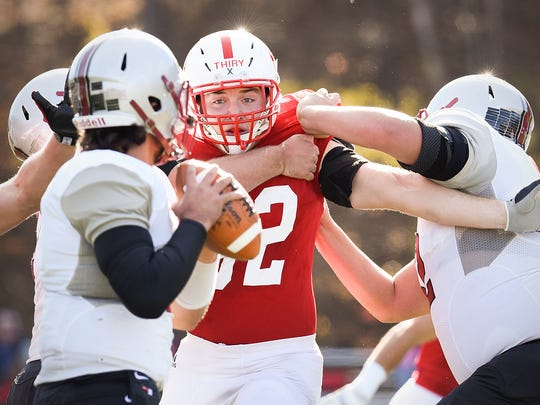 St. John's nose tackle Peyton Thiry fights his way toward Hamline quarterback Justice Spriggs during the first half Saturday, Nov. 5, at Clemens Stadium.