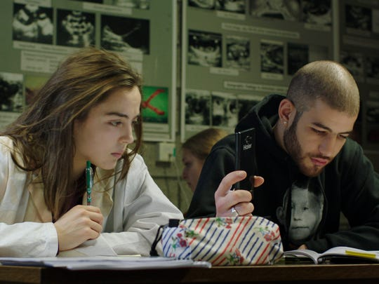"""In """"Raw,"""" Justine (Garance Marillier) and Adrien (Rabah Nait Oufella) are classmates."""