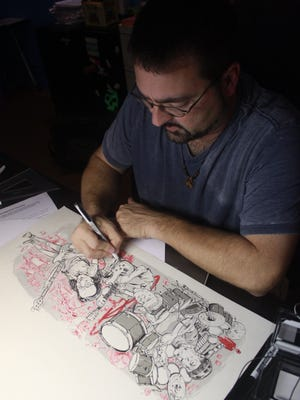 Jeremie Lederman, pictured working on an illustration commemorating the band Rush, is available to collaborate and help people understand what it takes to improve their drawing skills.