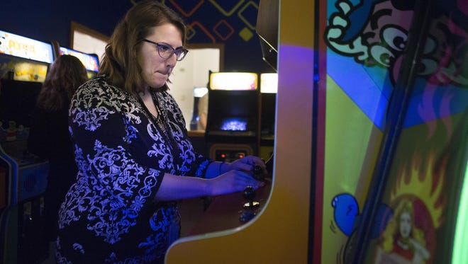 Melissa Fanton, an intern at Strong Museum, plays Super Mario Bros. following the World Video Game Hall of Fame induction ceremony on Thursday.