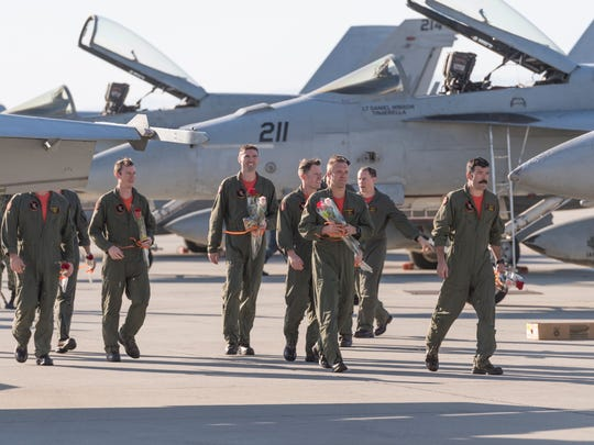 "Navy airmen based in Naval Air Station Lemoore return home on Monday, December 4, 2017. ""Argonauts"" of Strike Fighter Squadron (VFA) 147, ""Black Knights"" of VFA 154 and ""Blue Diamonds"" of VFA 146 arrived in waves throughout Monday. More are arriving Tuesday for a total of nearly 750. They are returning from a six-month deployment aboard the aircraft carrier USS Nimitz to the Indo-Asia-Pacific region and the Arabian Gulf."