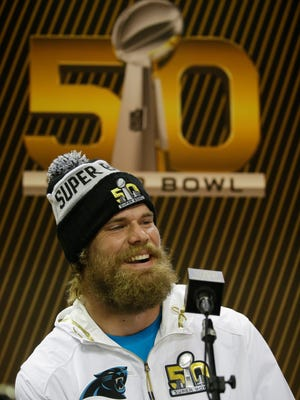 Carolina Panthers tight end Greg Olsen listens to a question during Opening Night for the NFL Super Bowl 50 football game Monday, Feb. 1, 2016, in San Jose, Calif. (AP Photo/Marcio Jose Sanchez)