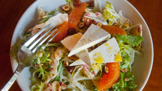 Lupo Restaurant's fennel and citrus salad is made with cara cara orange slices, candied hazelnuts, radicchio, frisee and salted ricotta and is topped with a drizzled honey-sherry vinaigrette.Mar. 16 2018