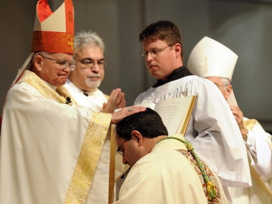 FILE: Archbishop Alfred Hughes, of New Orleans, ordains Monsignor Michael Duca as the second bishop of the diocese of Shreveport May 19, 2008, at the Shreveport Convention Center.