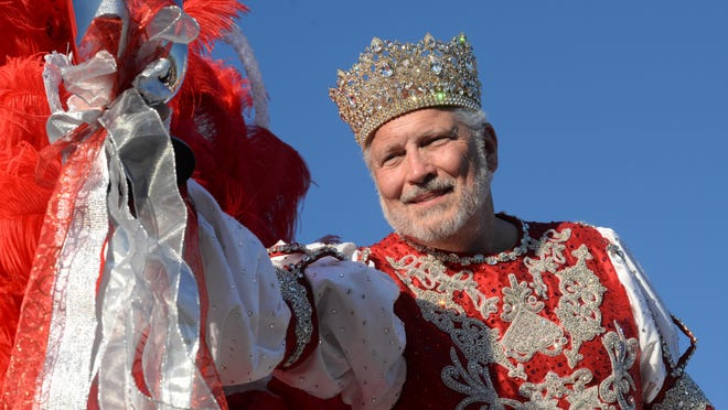 Taylor Brown, King of the Krewe of Gemini lifts his goblet to toast the crowd during the Krewe of Gemini Parade.