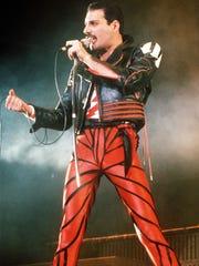 Singer Freddie Mercury of the rock group Queen performs