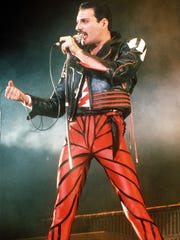 Singer Freddie Mercury of the rock group Queen performs at a concert in Sydney, Australia, in 1985.