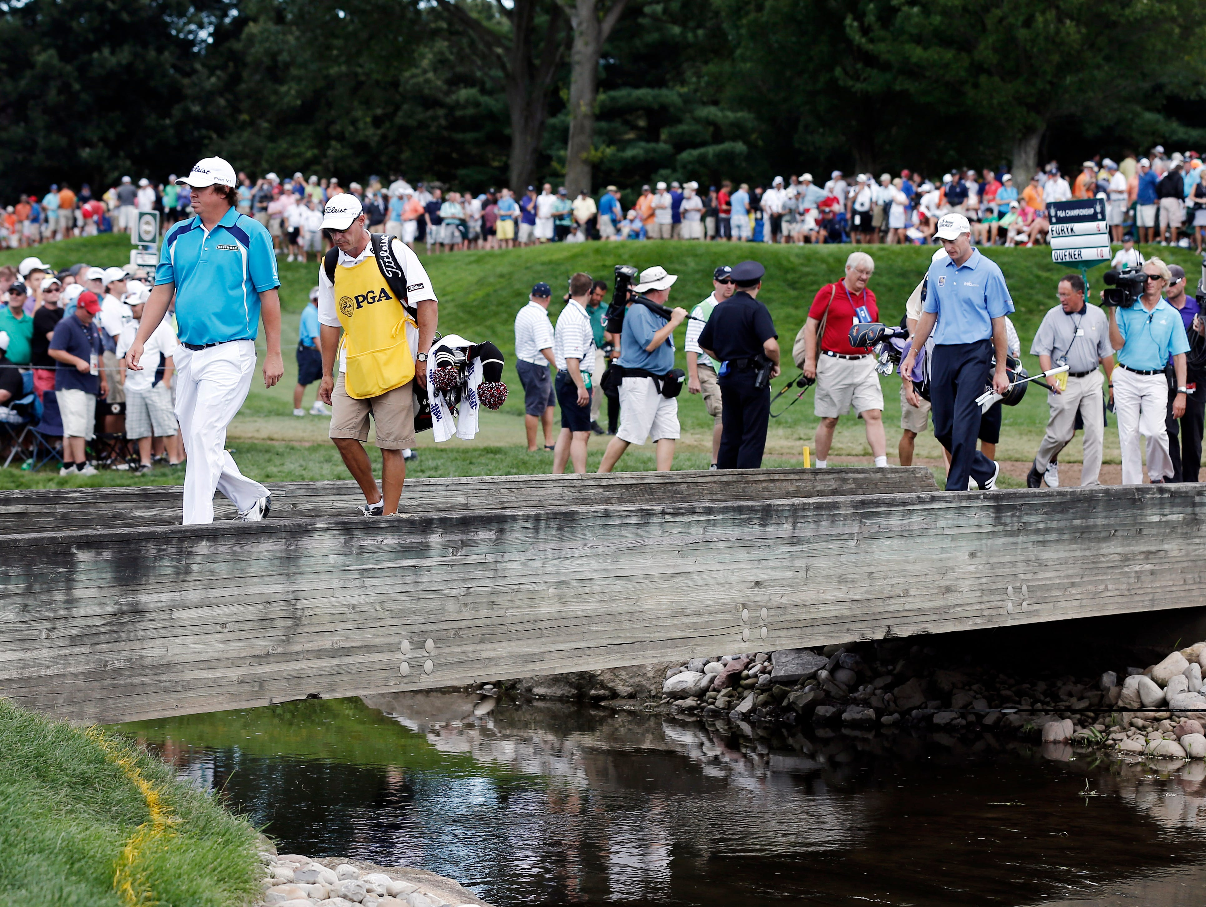 Jason Dufner and Jim Furyk walk to the sixth green.