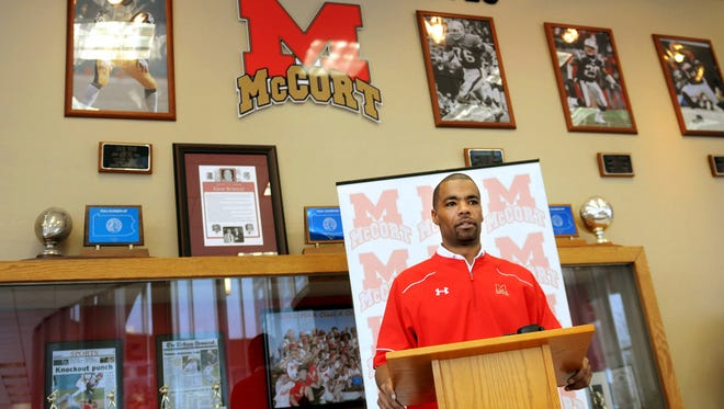 """This file photo from Feb. 18, 2015, shows former NFL player Artrell Hawkins Jr. during a news conference when he was named as head coach at Bishop McCort High school in Johnstown, Pennsylvania. The western Pennsylvania Catholic school rescinded its decision to hire Hawkins, a spokesman for the school said Monday, Feb. 23, 2015, that the """"formal process"""" and """"protocols"""" used to hire its coaches were not followed before the school announced that it hired Hawkins Jr. as head football coach. t, Thomas Slusser, File)  MANDATORY CREDIT"""