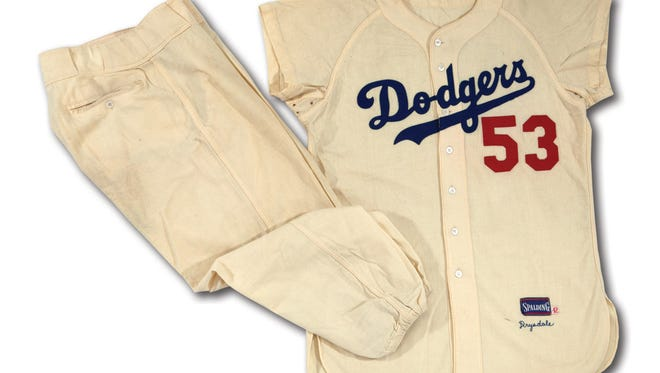 This undated photo provided by SCP Auctions shows former major league pitcher Don Drysdale's 1956 Brooklyn Dodgers home uniform.