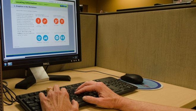 A staff member at WorkOne in Wayne County demonstrates how to use the WIN practice exam program at the WorkOne facility in Richmond on Friday, July 15, 2016