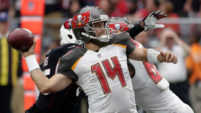 Tampa Bay Buccaneers quarterback Ryan Fitzpatrick (14) throws a pass against the Arizona Cardinals during the first half Sunday.