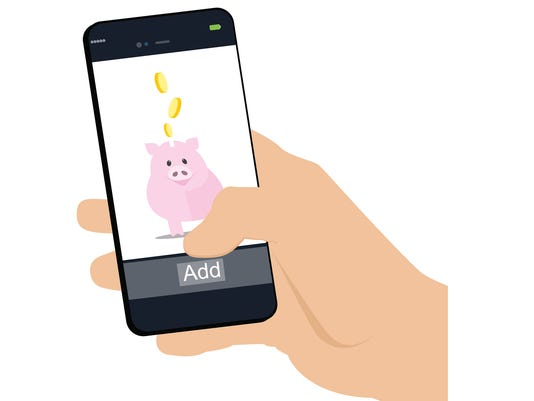Mobile banking , hand holding  phone and fills his piggy bank