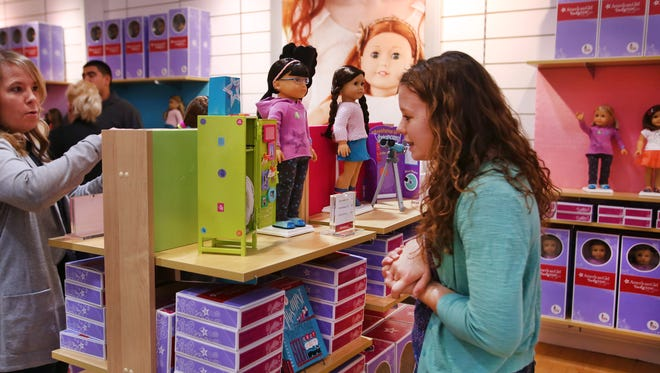 Kara Hollinger, 15, New Madison, Ohio, visits the new American Girl doll store at Castleton Square Mall in Indianapolis, a temporary holiday store offering a section of dolls, books and accessories.