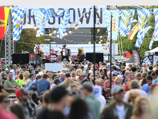 A crowd fills Oregon Avenue during the first day of Octoberfest in Downtown Bend Sept 16, 2016. Bend is one of two Oregon towns to rank among the best in the country to live. High incomes and a low cost of living make the area especially attractive. The typical household earns $60,784 a year — about $3,000 more than the typical American household. Goods and services are also 2.6% less expensive in Bend on average than they are nationwide.