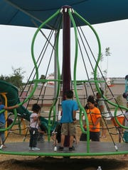 Students try out the new playgrounds at Desert Willow.