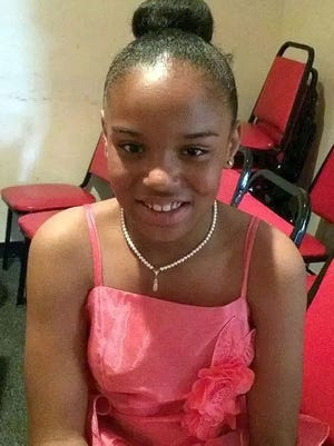 Veronica Roach, 10, was strangled on Aug. 1, 2014 and is shown in a photo supplied by her mother Jasmine Roach.   Veronica and Joan Colbert, 62, were found dead in their first floor apartment at 61 Lippincott Avenue in Long Branch.      FAMILY PHOTO~