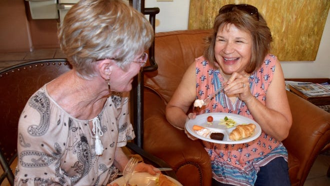 Friends Sue Spence, left, and Winnie Sutley share a laugh at a local potluck gathering in observance of National Neighborhood Day, Thursday, September 14, 2017.