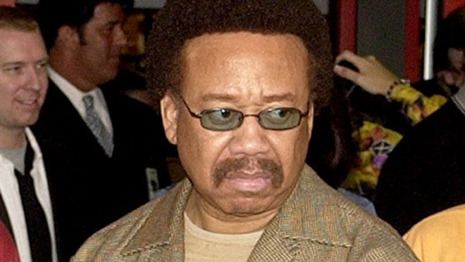 In this July 7, 2003 file photo, Maurice White, of Earth, Wind, & Fire, appears at an induction ceremony at the Hollywood Rock Walk in the Hollywood section of Los Angeles. White, the founder and leader of Earth, Wind & Fire, died at home in Los Angeles, Wednesday, Feb. 3, 2016, said his brother, Verdine White. He was 74.