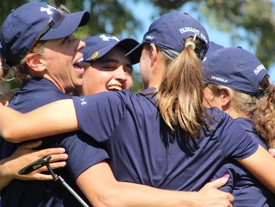 The Farragut girls golf team celebrates after completing