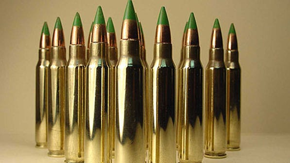 """A display of 5.56 NATO armor-piercing bullets – so-called """"green tip"""" rounds."""