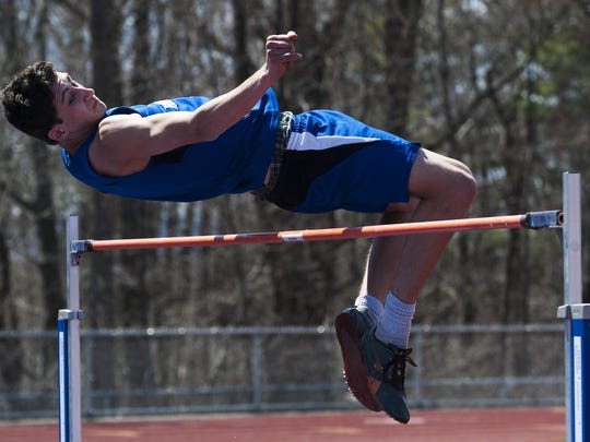U-32's Henry John competes in the boys high jump during the Burlington track and field invitational last month.