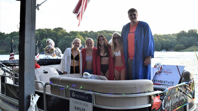 Graduating seniors from the class of 2020 who are Lake Buckhorn residents and members received a special presentation from Lake Buckhorn residents John and Mary Jo Miller prior to setting off on the July 4 Boat Parade at Lake Buckhorn. The graduates were presented with a certificate of appreciation and a rose and some other goodies. Graduates in the boat parade were, from left: Kaylee Farr, who attended Magnificat High School and will attend Ohio State; and West Holmes graduates Megan Mellor, who will attend Stark State; Maddie DeWitt, who will attend Kent State; Morgan Mellor, who will attend Kent State; and Kadyn Evans, who will attend Denison. Two other West Holmes graduates/residents, Colin Graebner and Ava Close, were unable to attend. The boat was piloted by John Adams.