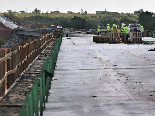 Bridge construction workers have about 90 days left in the project contract as they replace the 1930s-era bridge on State Highway 79 into Oklahoma.