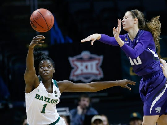 Baylor forward Dekeiya Cohen (1) steals the ball as Kansas State guard Kayla Goth (10) passes in the first half of an NCAA college basketball game in the quarterfinals of the women's Big 12 conference tournament in Oklahoma City, Saturday, March 3, 2018. (AP Photo/Sue Ogrocki)