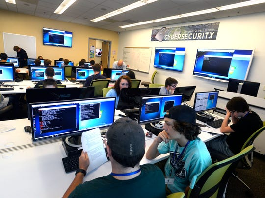 University of West Florida students at work in the university's Center for Cybersecurity.