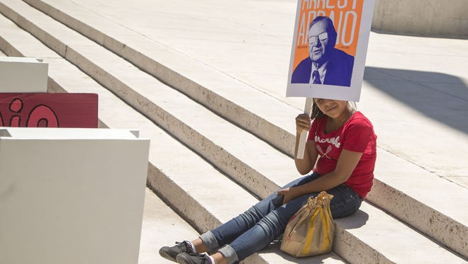 Kimberly Lopez, 13, protests with Puente Arizona at Sandra Day OÕConnor Federal Courthouse on Tuesday, May 31, 2016. Attorneys in court for Sheriff Joe Arpaio and the ACLU argue what penalties a judge should assess after Arpaio and his deputies were found in civil contempt of a judge's order on Tuesday, May 31, 2016.