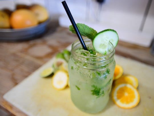 "Rehoboth Ale House ""Gin-Jar"" is made with gin, muddled cucumbers, mint, fresh squeezed lime, house made ginger simple syrup and a splash of soda water."