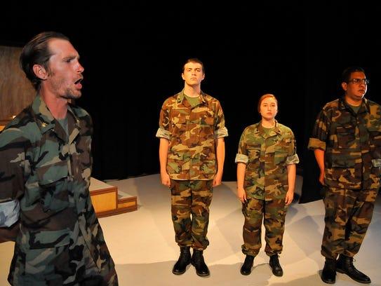 Patrick Greer speaks to his soldiers Bryce Huckabay,